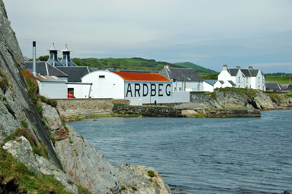 Picture of Ardbeg distillery and pier seen from the shore