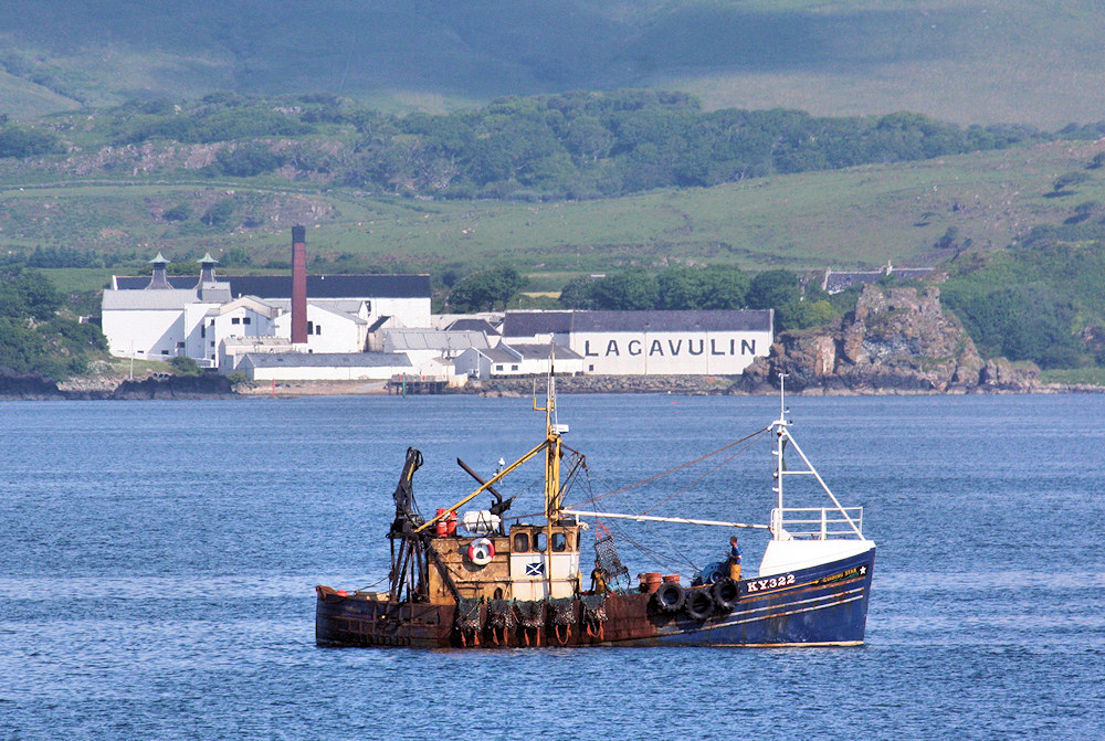 Picture of a fishing boat off a coastal distillery