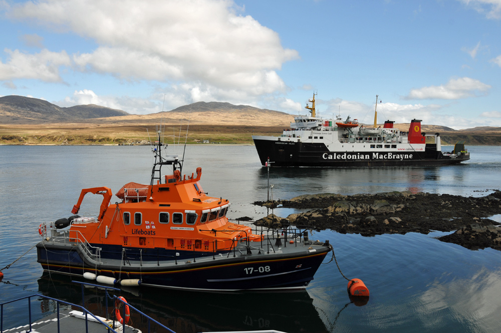 Picture of the Islay lifeboat with the Islay ferry MV Hebridean Isles arriving behind