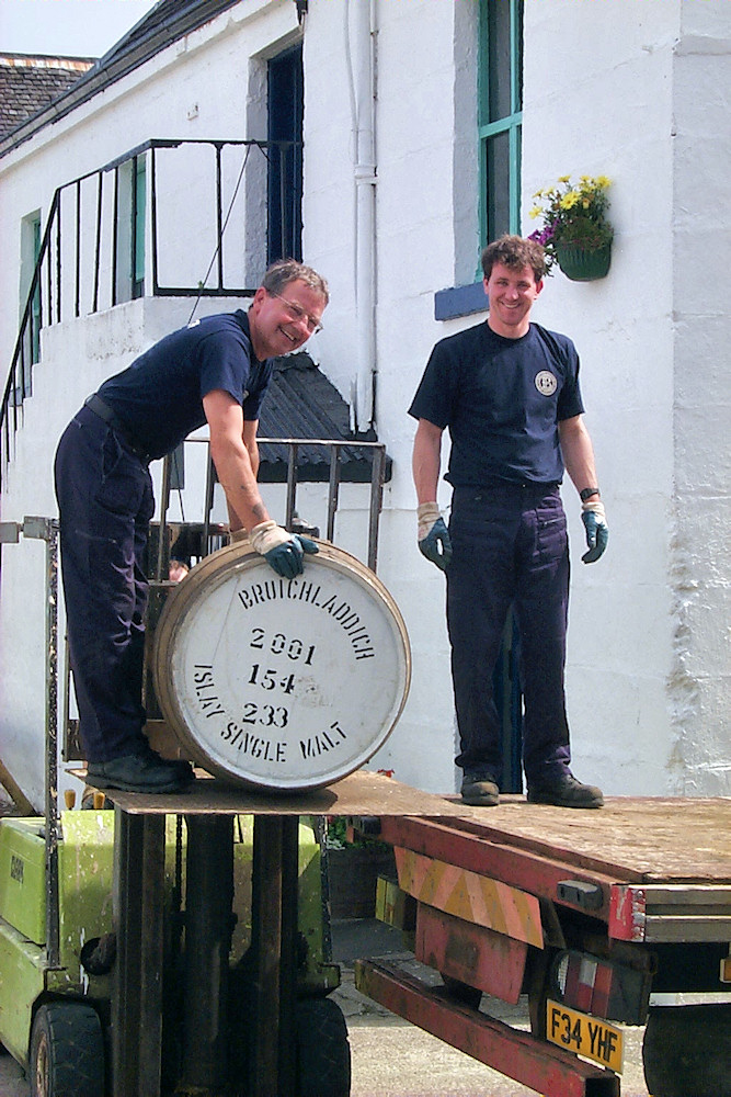 Picture of two workers loading Bruichladdich whisky casks on to a lorry