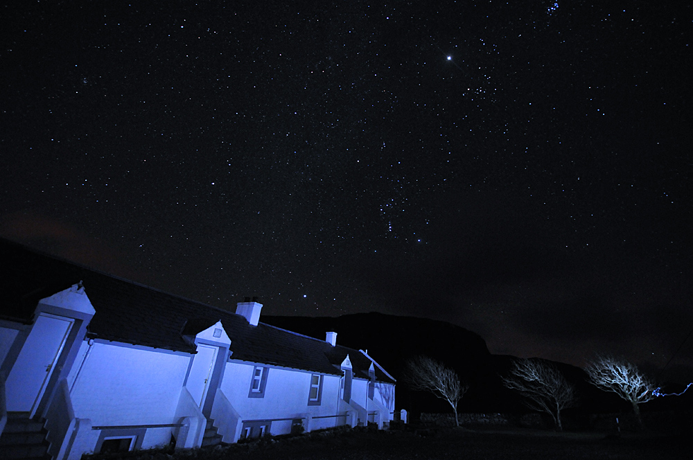 Picture of the night sky above a row of cottages