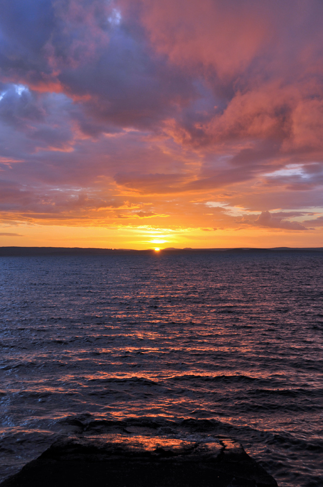 Picture of a sunset seen across a sea loch
