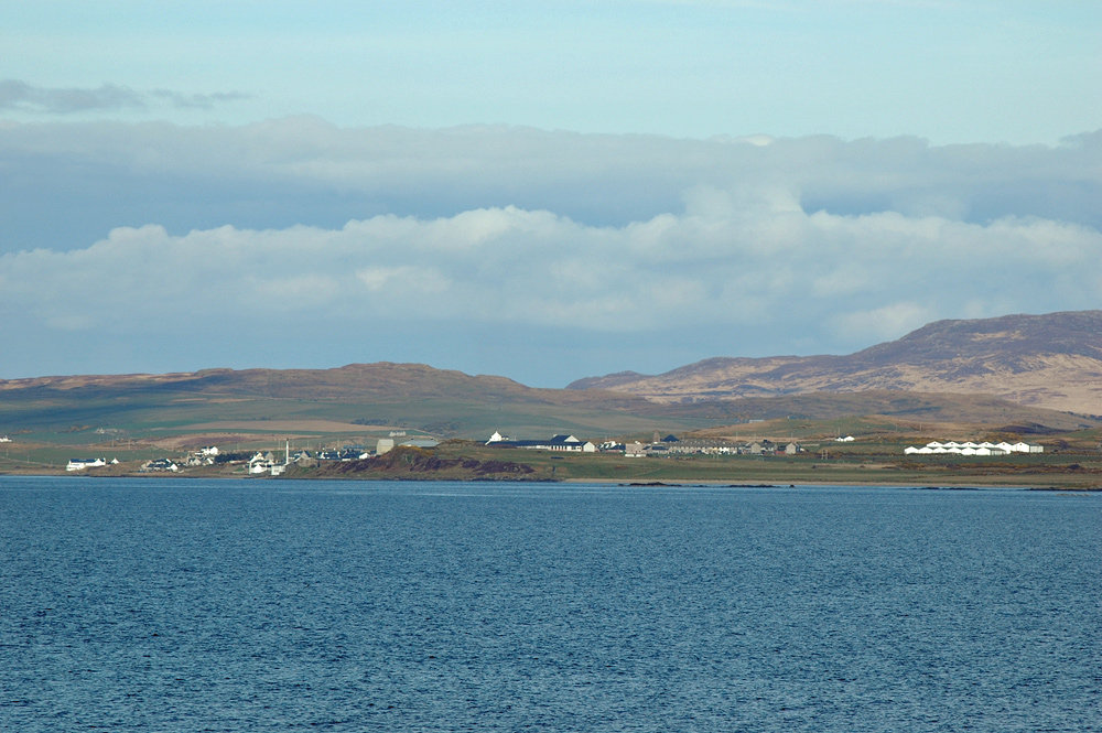 Picture of a coastal village seen across a sea loch