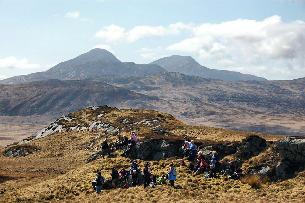 Picture of walkers resting in a rugged landscape on Jura