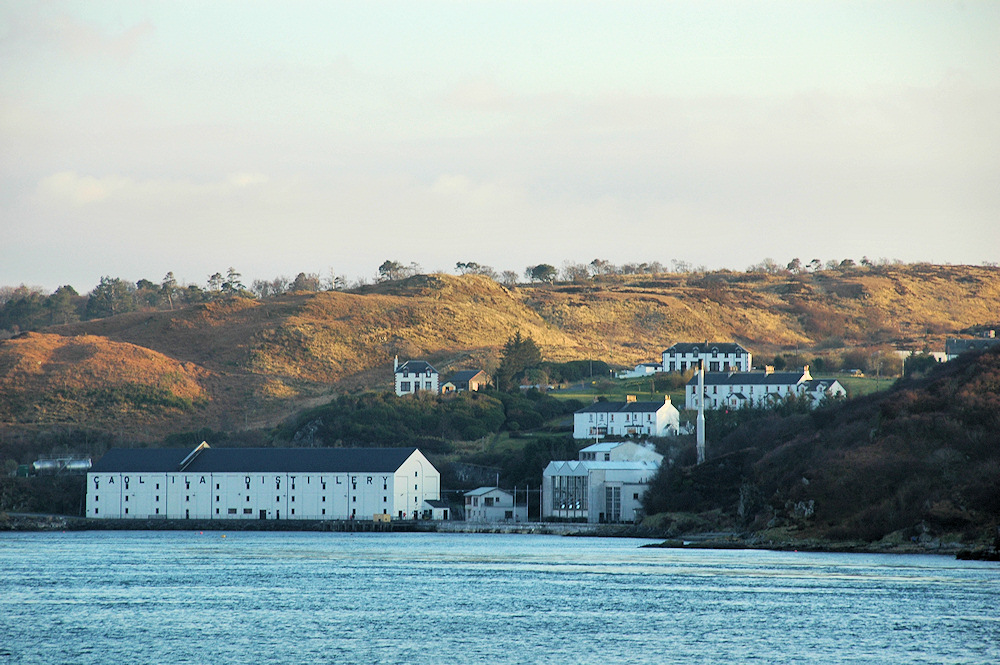 Picture of a distillery at a sound in mild evening light