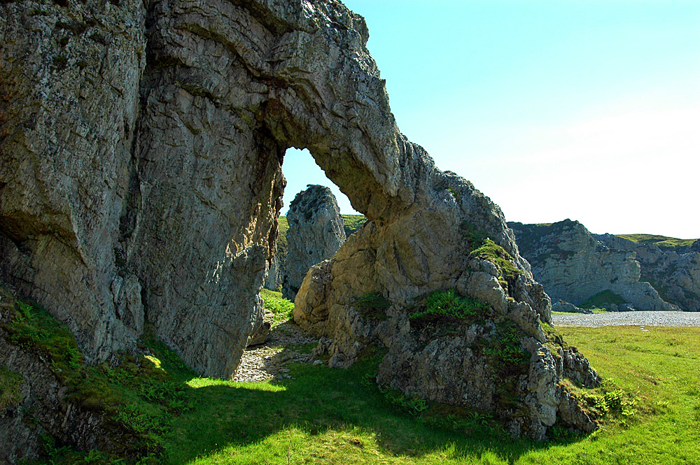 Picture of a natural arch on a shoreline
