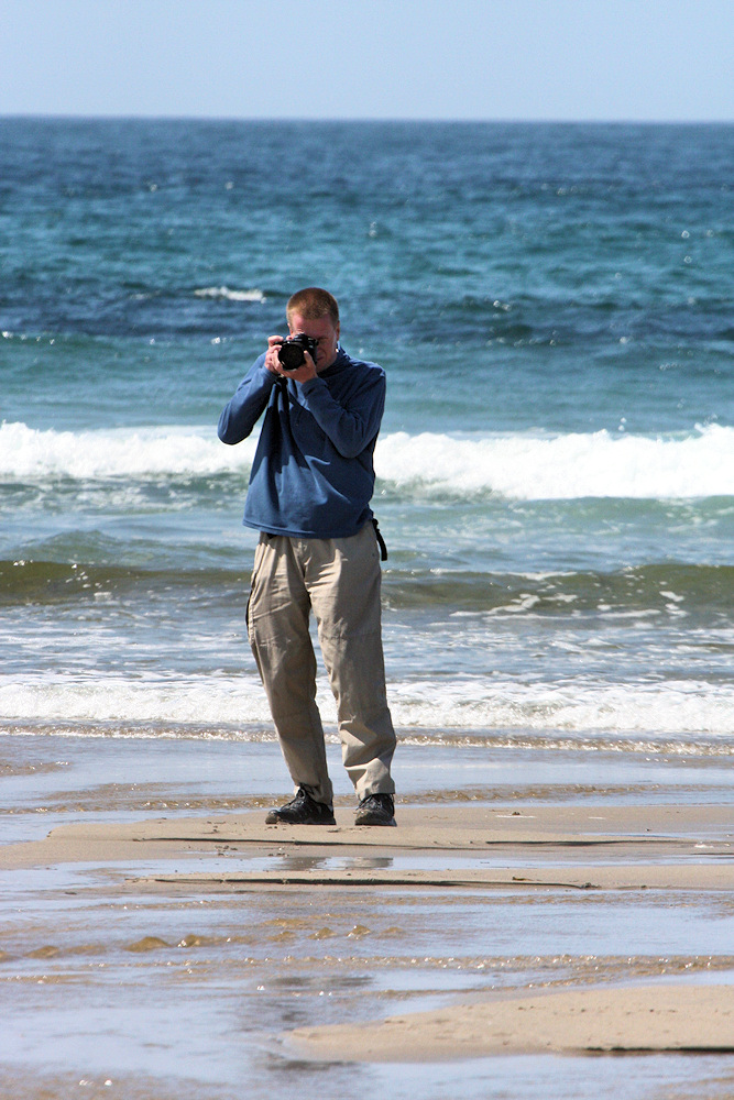 Picture of a man taking pictures on a beach