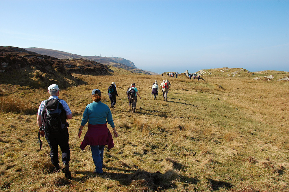 Picture of a group of walkers arriving at the ruin of an old cottage where a swordmaker used to live