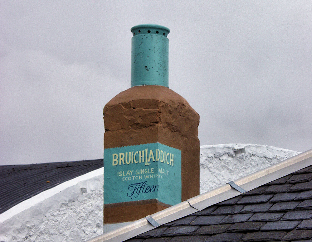 Picture of a chimney painted like a Bruichladdich whisky bottle