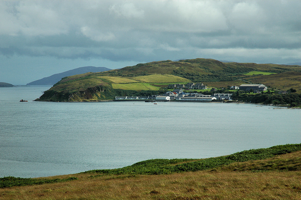Picture of a distillery on a bay next to a sound