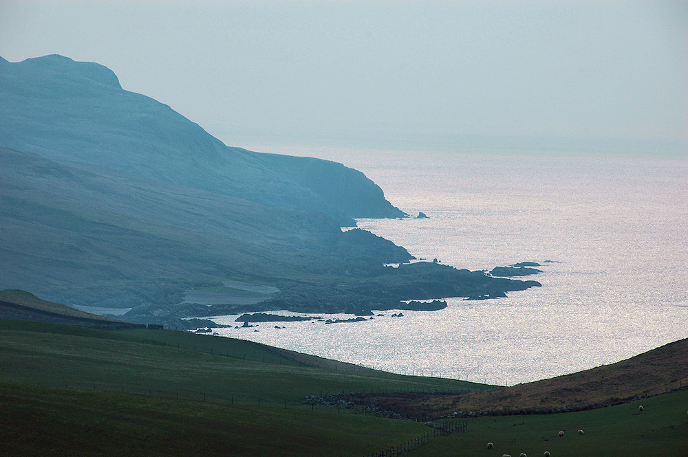Picture of a view over a coastline on a hazy afternoon