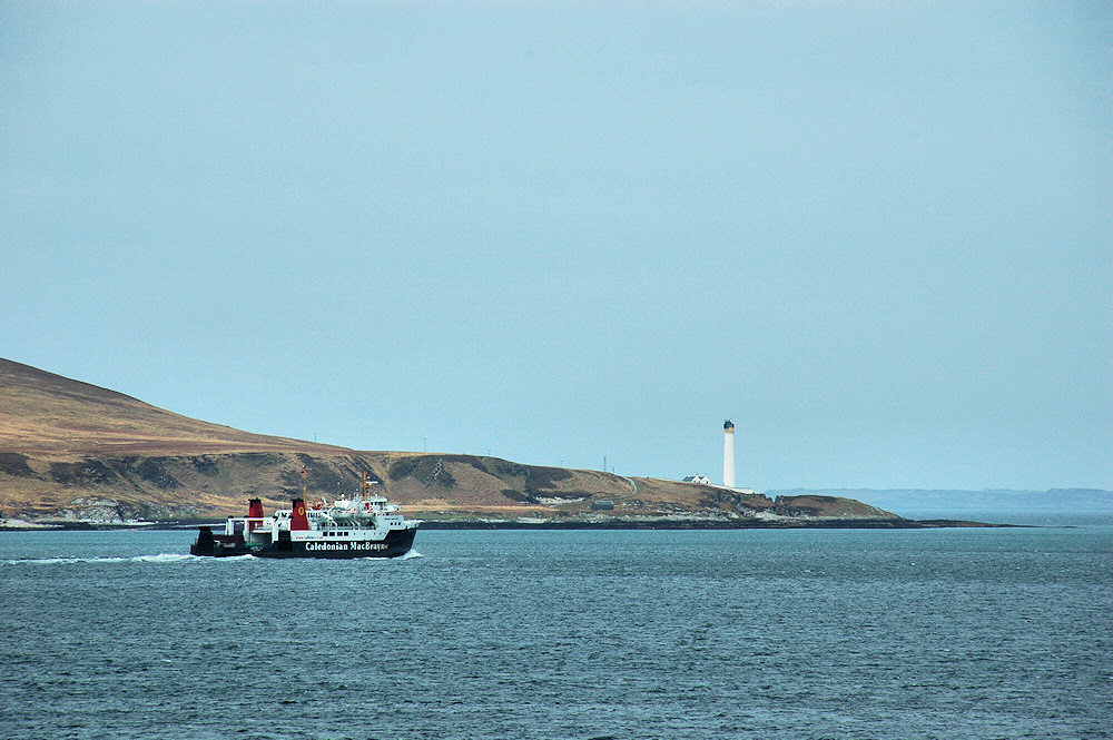 Picture of a Calmac ferry passing a lighthouse