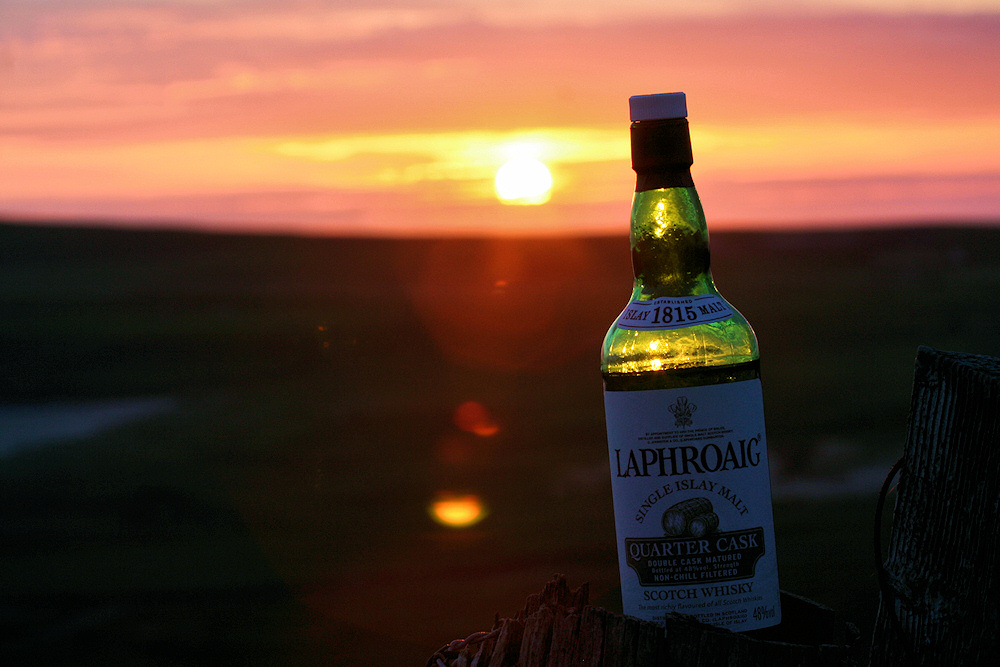 Picture of a bottle of Laphroaig Quarter Cask Islay single malt whisky at sunset