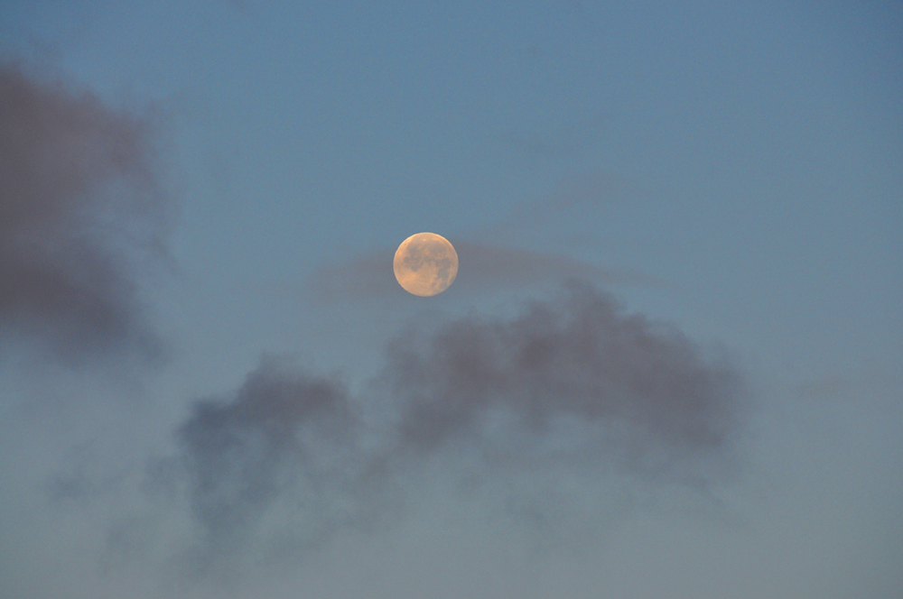 Picture of the moon and some light clouds