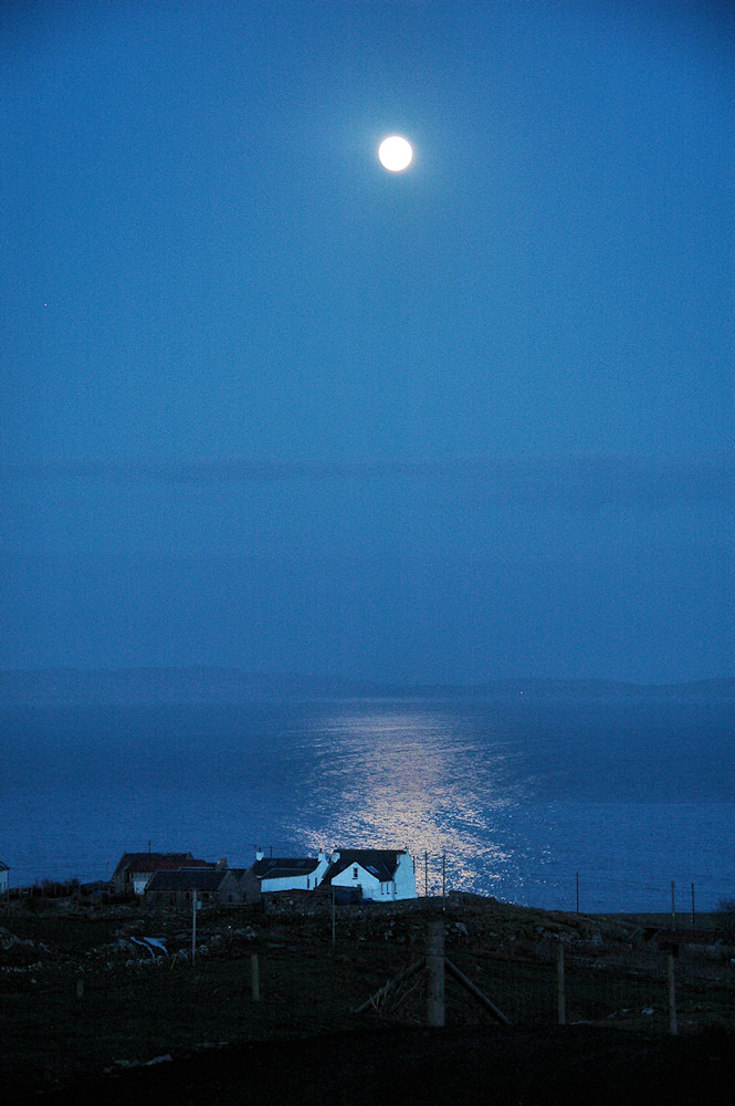 Picture of the Moon over a sea loch