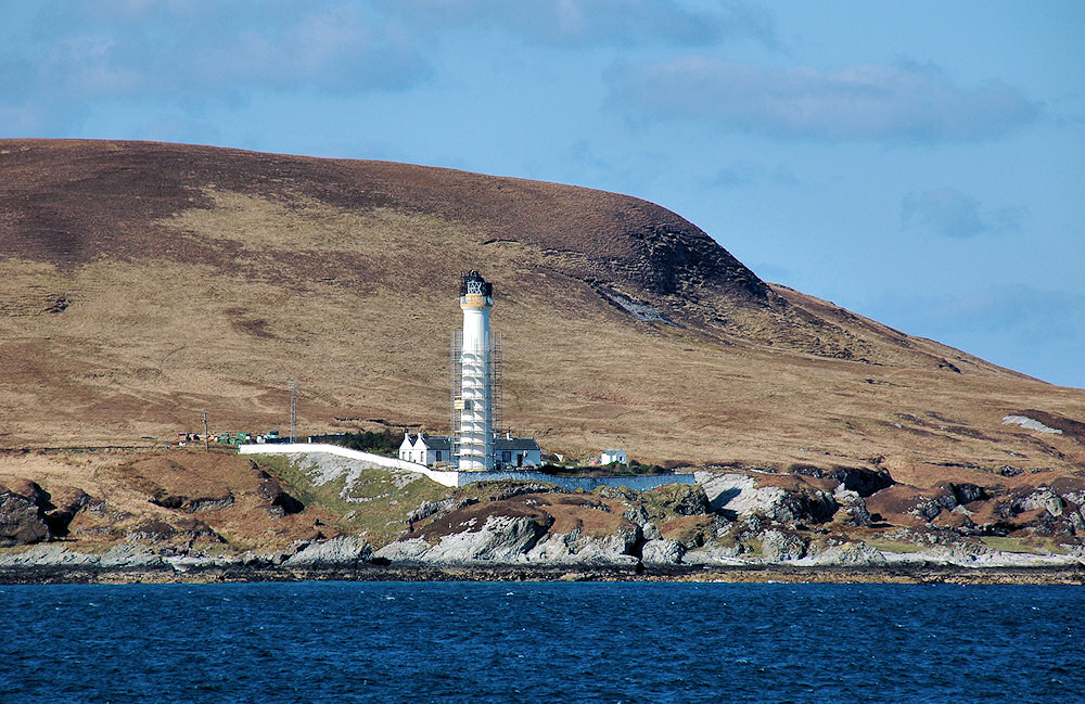 Picture of a lighthouse with scaffolding during some maintenance work