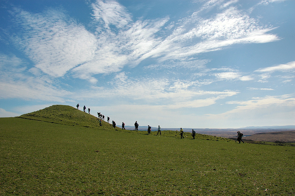 Picture of a row of walkers on a conical hill