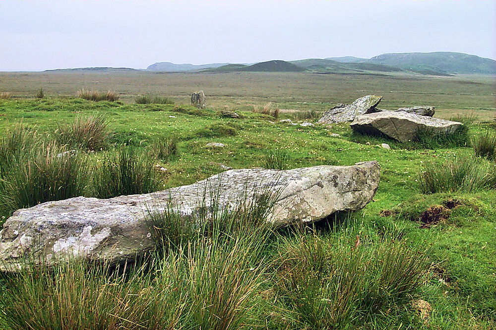Picture of the remains of a stone circle on a cloudy day