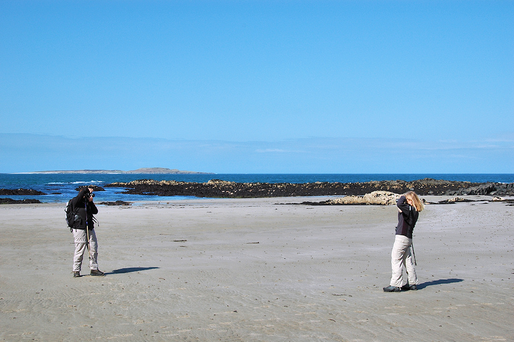 Picture of two photographers on a beach, taking pictures of each other