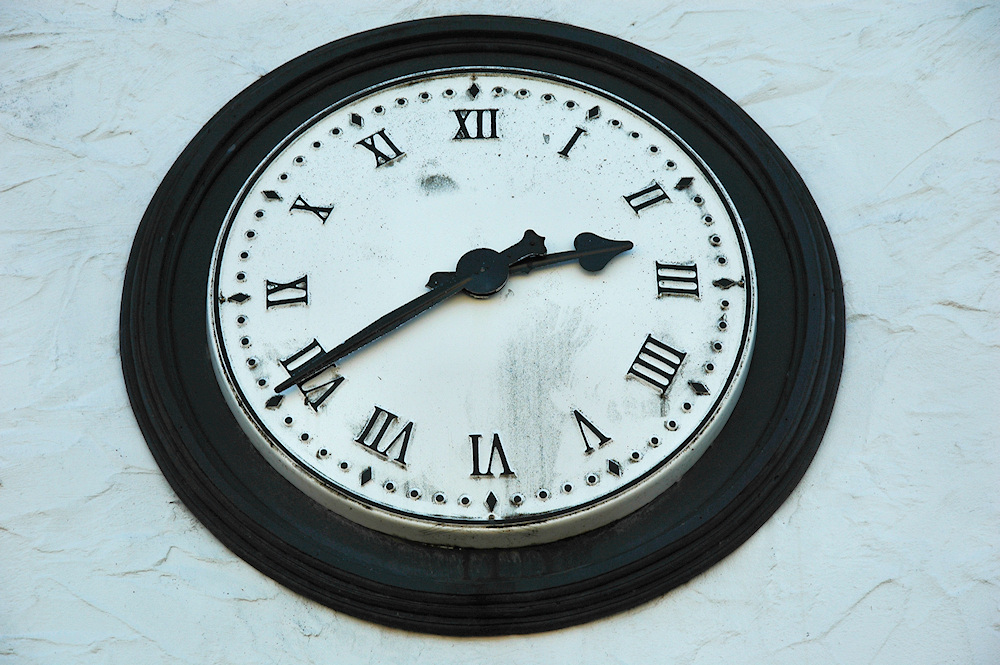 Picture of an old clock with Roman numerals