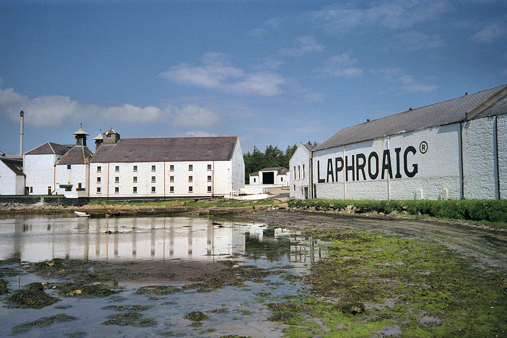 Picture of Laphroaig distillery from the shore of Loch Laphroaig