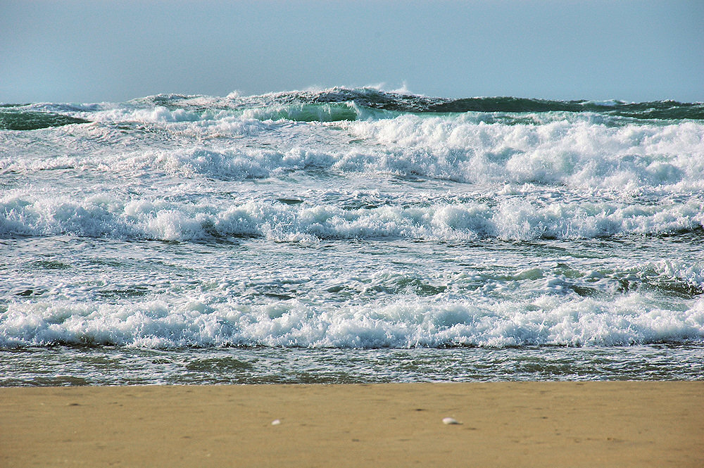 Picture of breaking waves rolling on to a beach