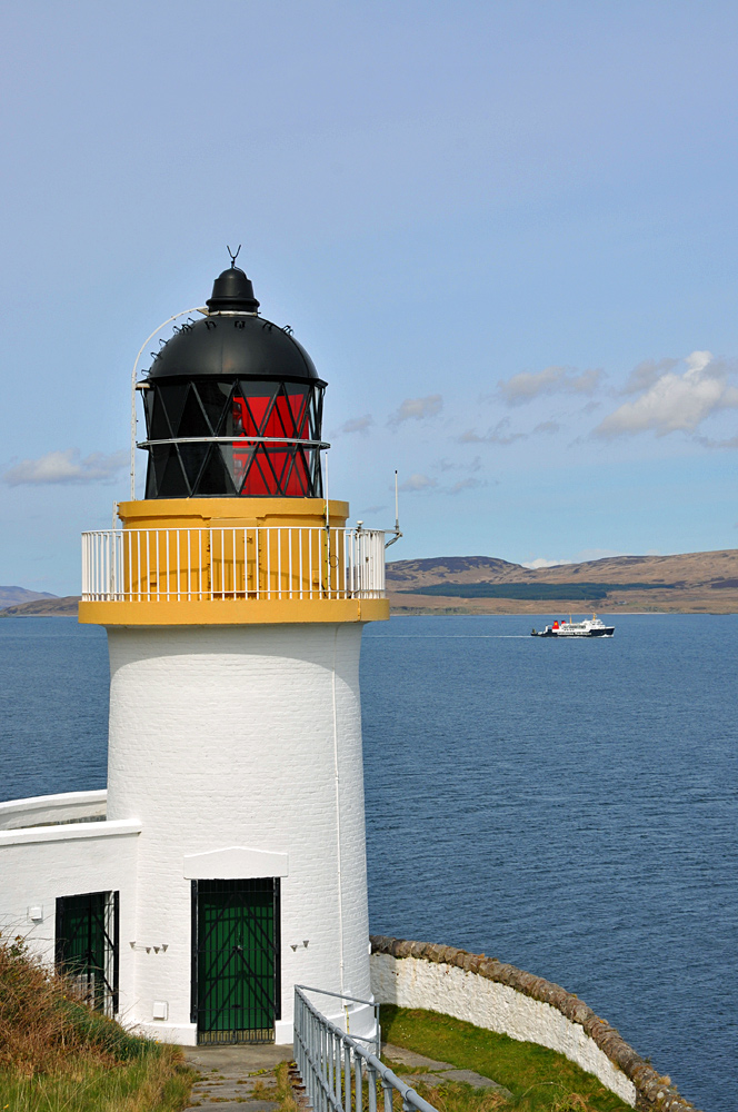 Picture of a lighthouse with a ferry passing
