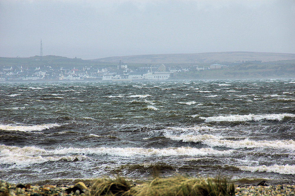 Picture of a view across a sea loch towards a village in stormy weather