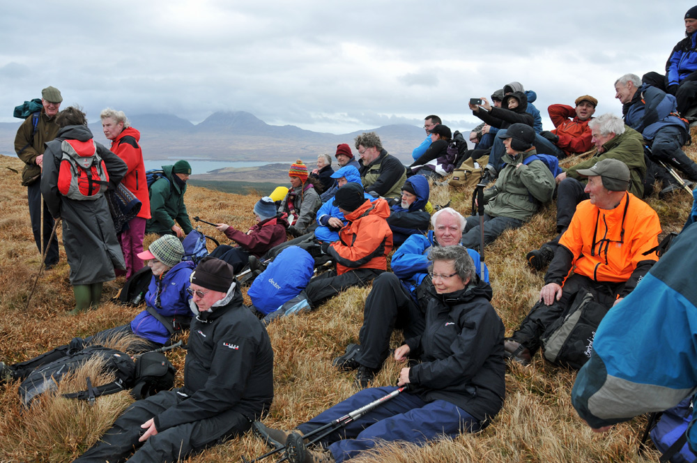 Picture of a group of walkers at a summit cairn