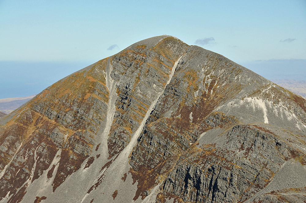 Picture of the top of a mountain with steep hill faces and scree