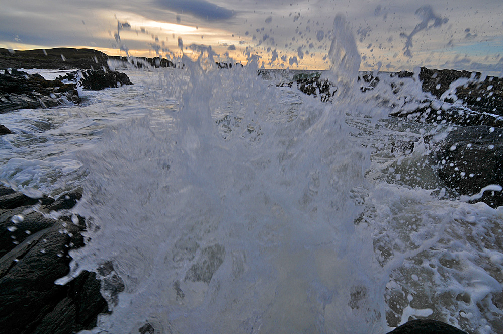 Picture of a big splash of water hurtling towards the camera