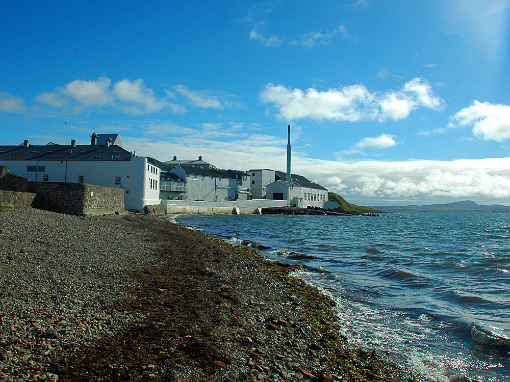 Picture of a coastal distillery next to a pebble beach
