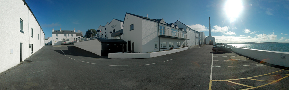 A panoramic view of Bowmore distillery on the shore of Loch Indaal