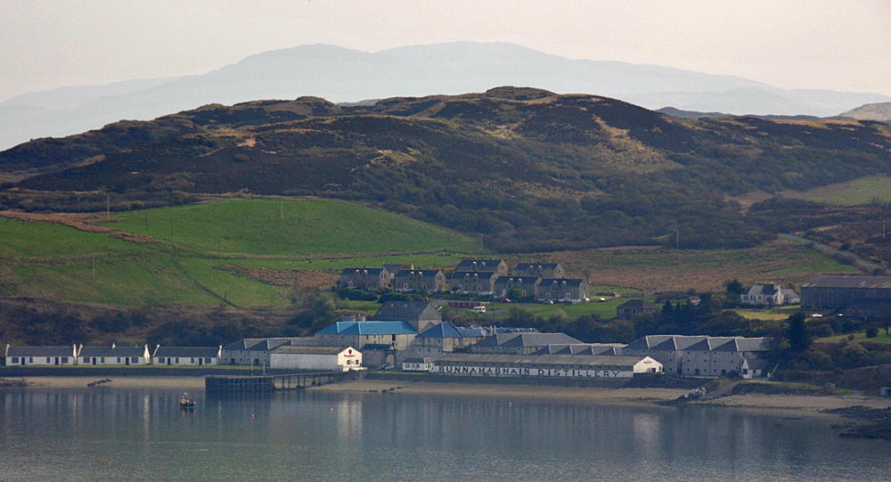 Picture of a coastal distillery on a very calm bay