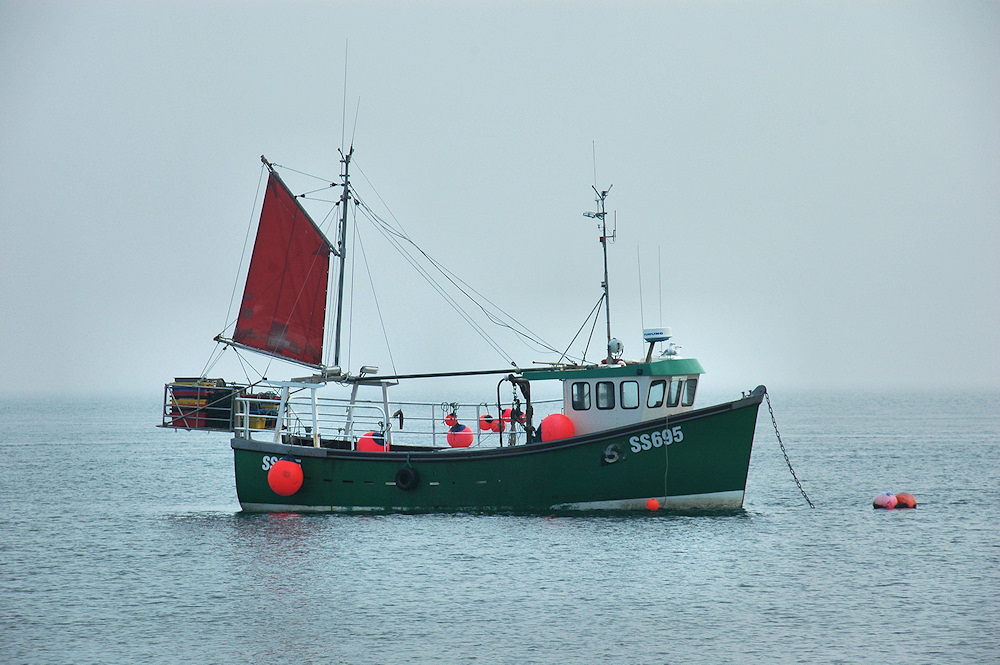 Picture of a fishing boat on a misty morning
