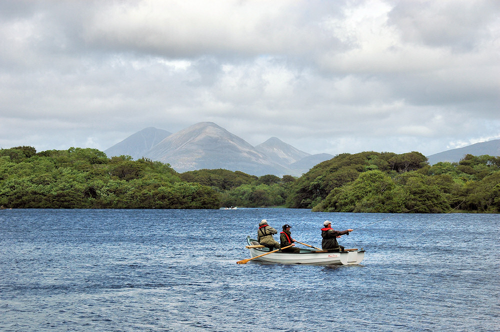 Picture of a boat on a loch with two flyfishers