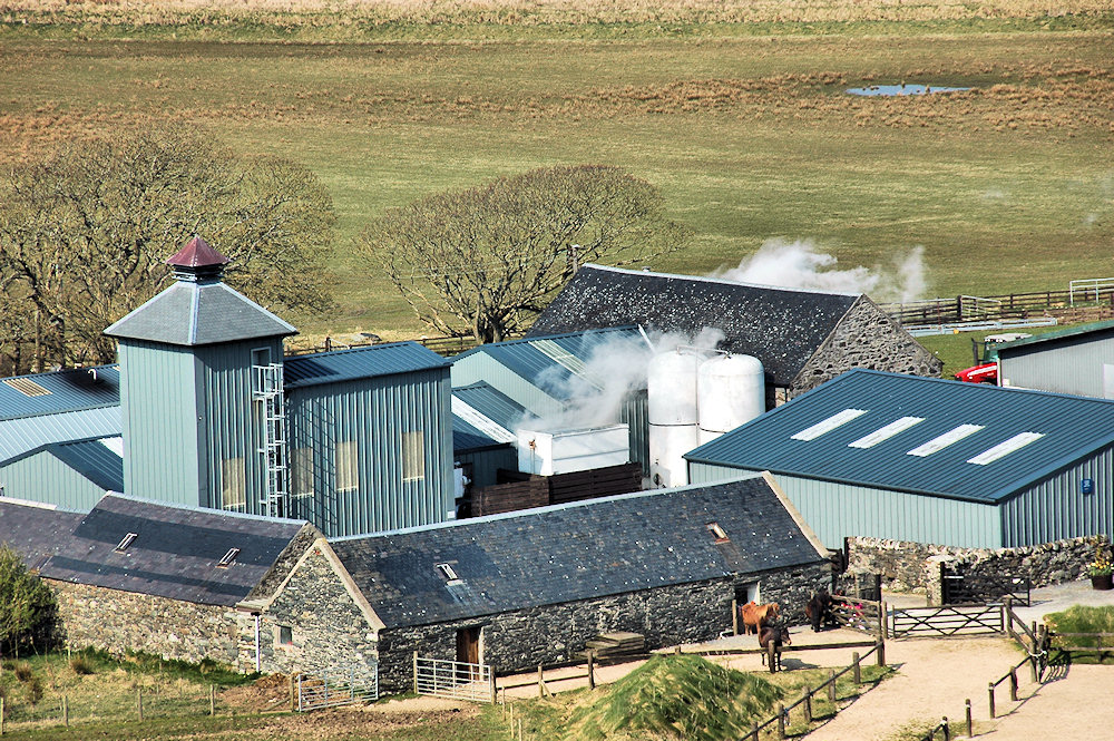 Picture of a small farm distillery seen from hills behind
