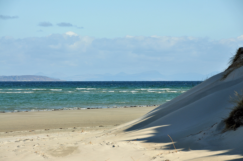 Picture of dunes, beach and blue seas on a sunny day