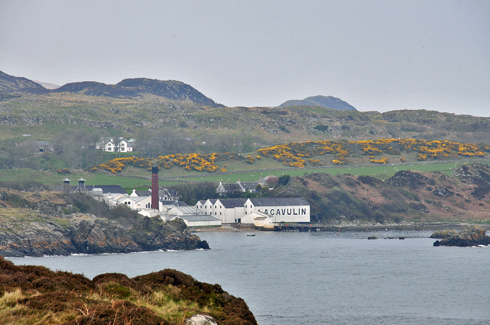 Picture of a coastal distillery seen from an offshore island