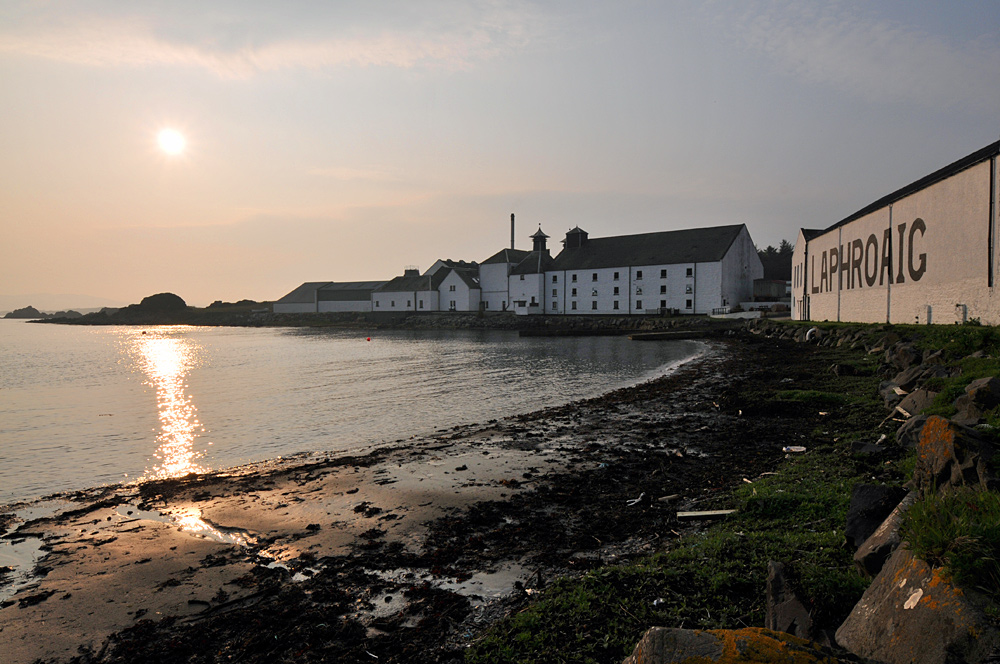 Picture of a sunset at a coastal distillery