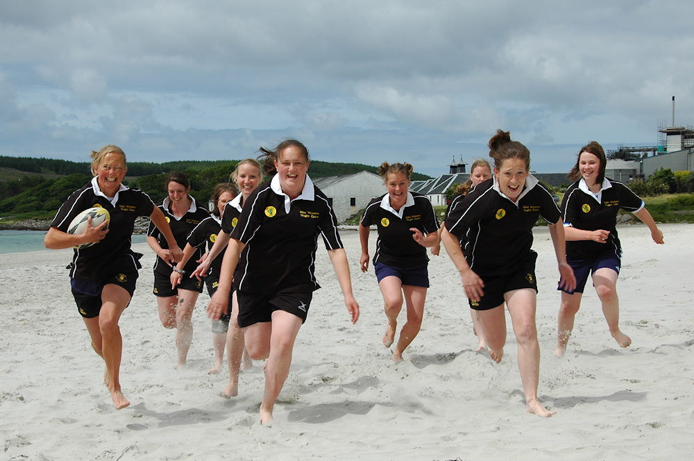 Picture of the Islay beach rugby women's team running towards the camera