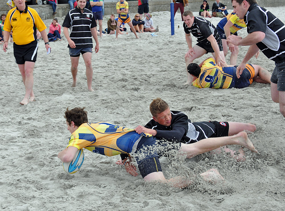 Picture of a beach rugby tackle