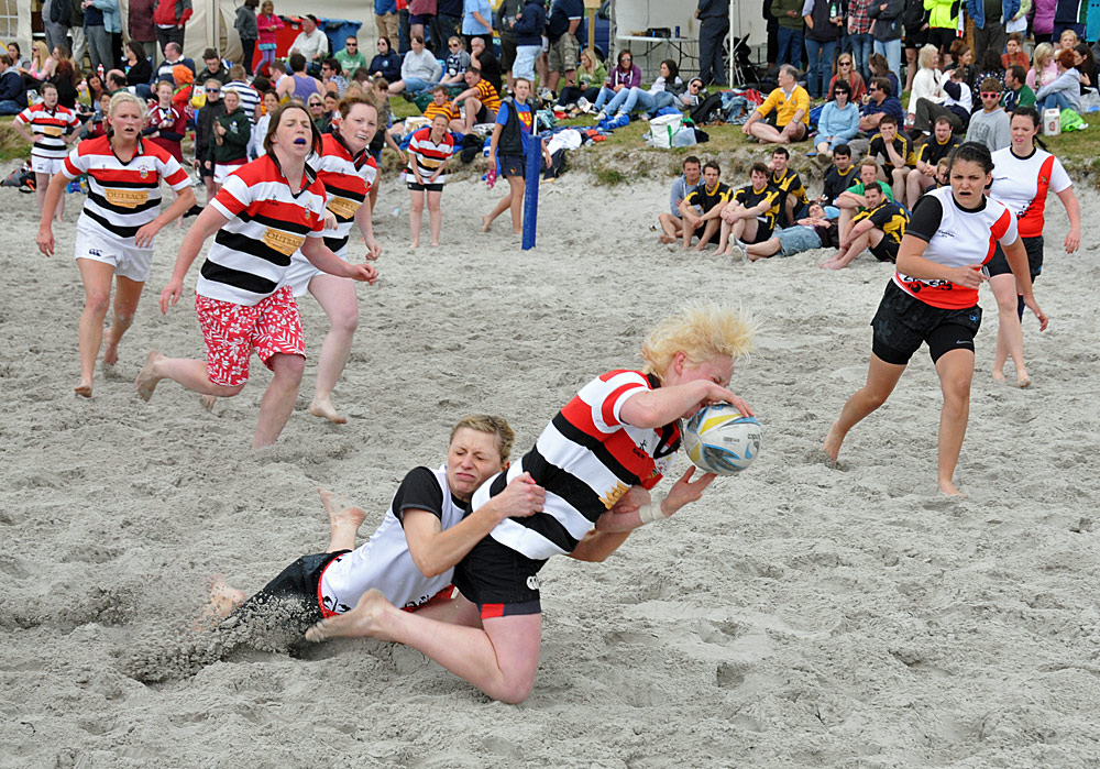 Picture of female beach rugby players in action