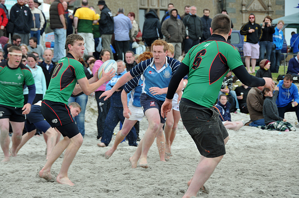 Picture of a beach rugby game in full flow