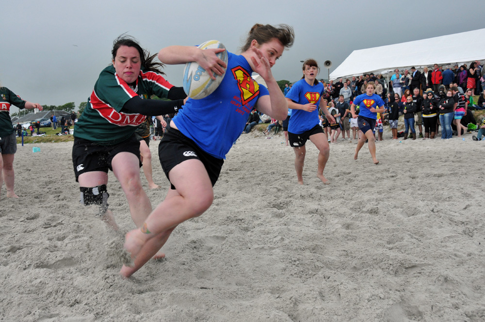 Picture of attacking play in a women's beach rugby game