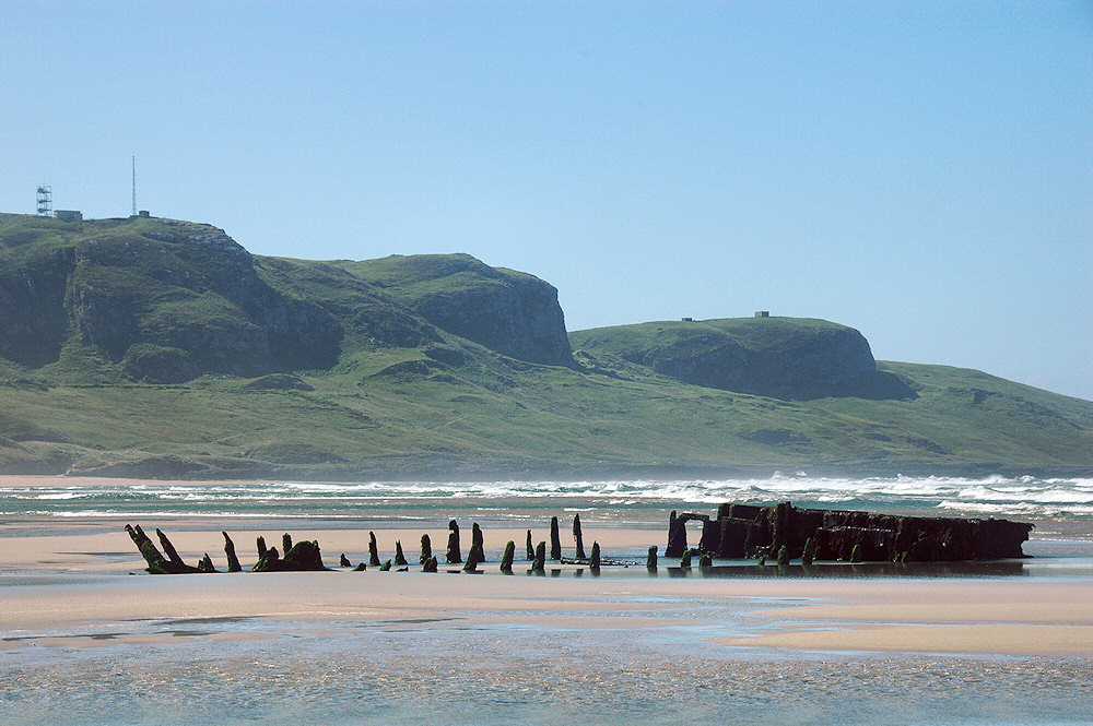 Picture of the remains of wreck on a beach at low tide