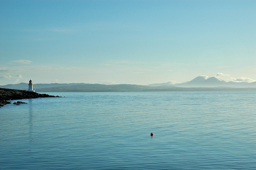 Picture of a view over a sea loch on a bright sunny morning