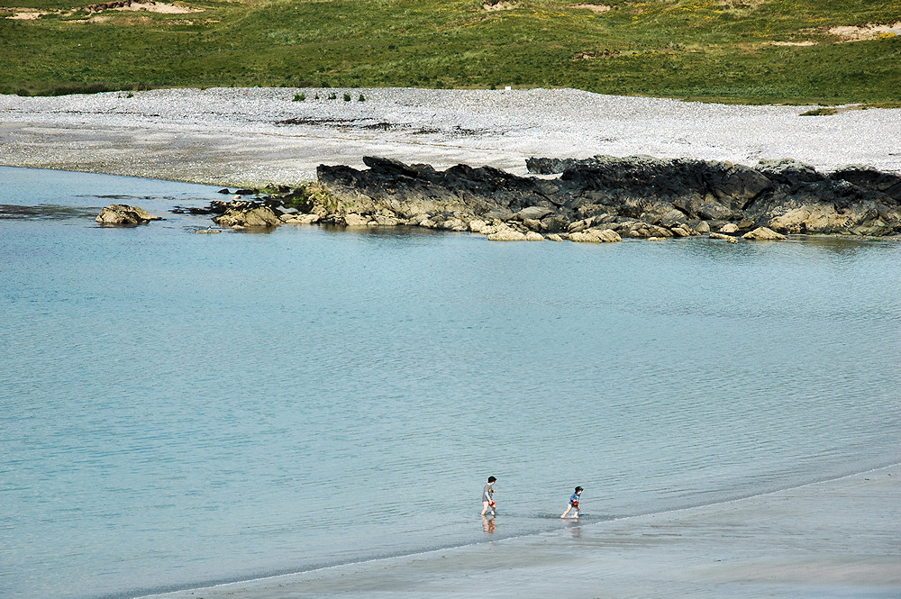 Picture of children running in the shallow water at a beach