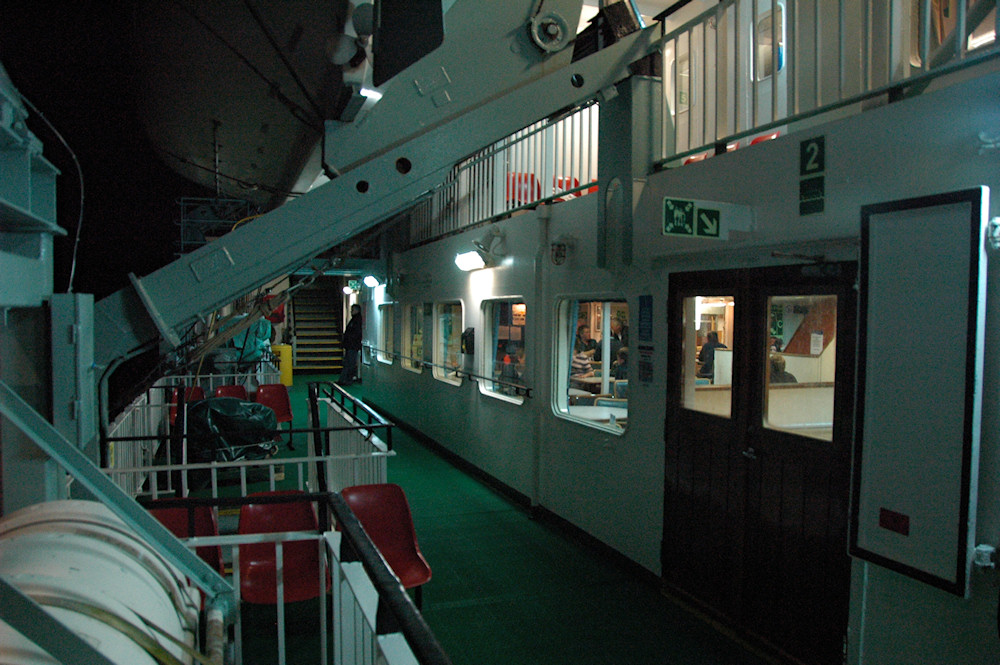 Picture of a view of the deck of a ferry at night