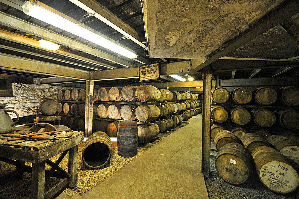 Picture of the inside of a warehouse at Laphroaig distillery on Islay